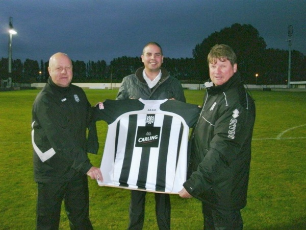Brigg Town's new first team kit is presented to manager Mick Gray (right) and assistant manager Paul Fenwick (left) by sponsors Molson Coors Brewery