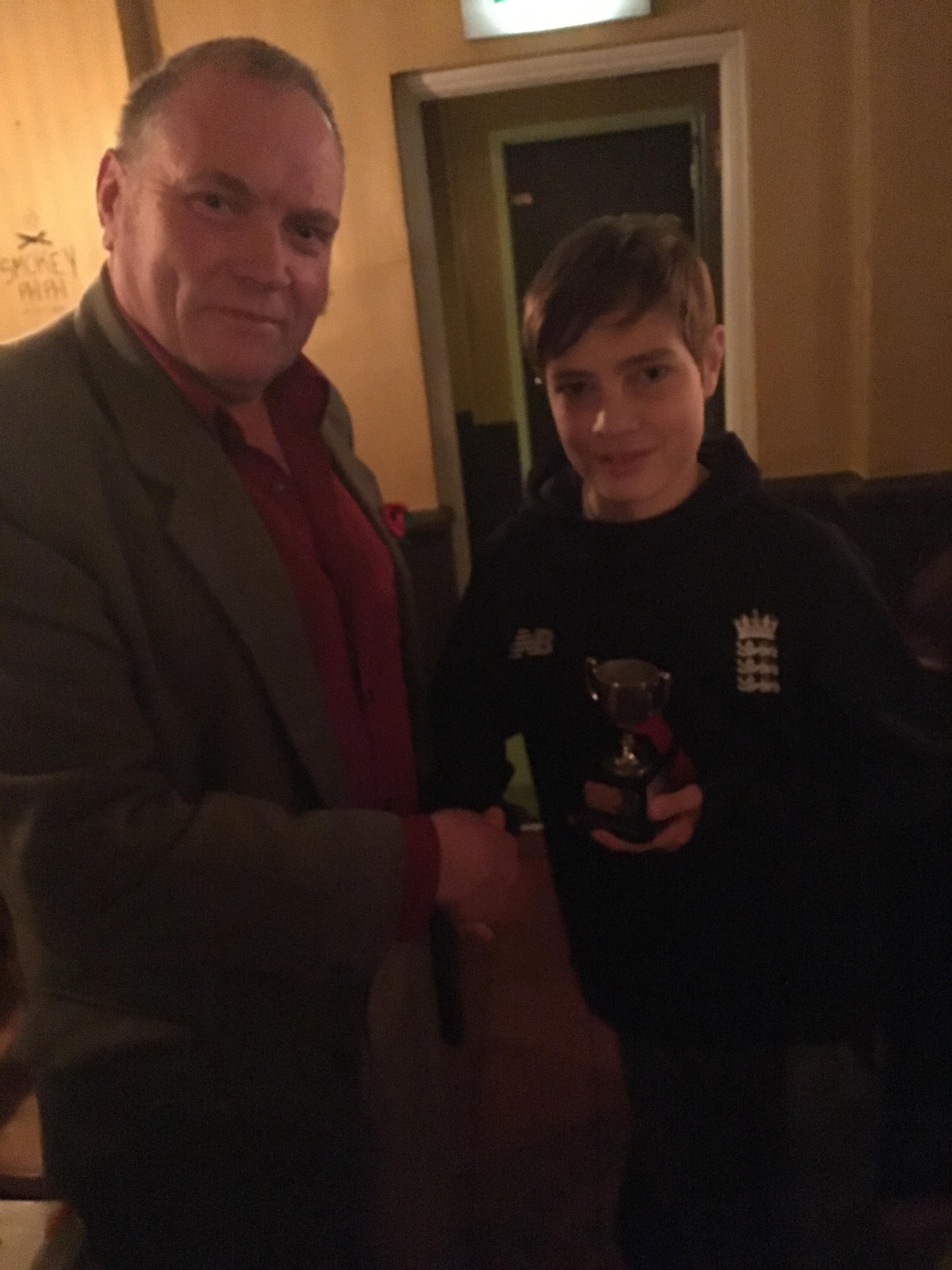 Joel receiving the young player award